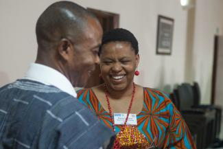 a male and female policymaker engage in lively conversation